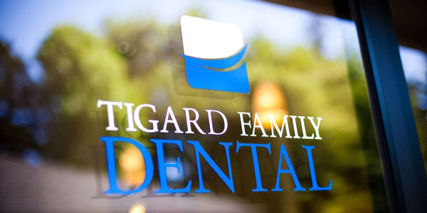 Tigard Family Dental's logo on their door in Tigard, OR