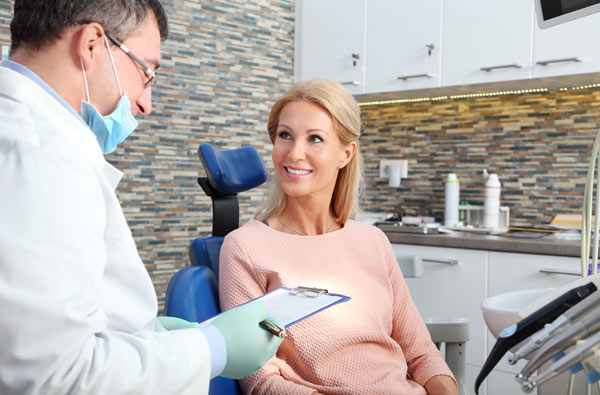 Woman asking questions to our dentist at Tigard Family Dental in Tigard, OR